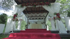 Outdoor wedding ceremony decoration - dolly shot - stock footage