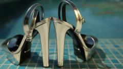 Elegant ceremony shoes next to the pool - dolly shot close-up - stock footage