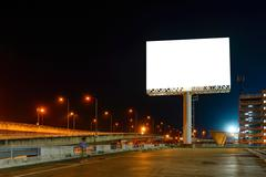 Stock Photo of Blank billboard at night for advertisement.