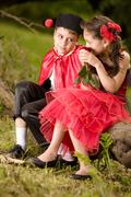 Portrait of a very young couple in spanish style garment - stock photo