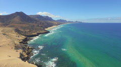 AERIAL: Stunning Cofete beach with vulcanoes and emerald ocean Stock Footage