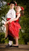 Lovely young couple dancing and having fun on a bridge - stock photo