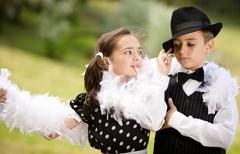 Lovely young couple dancing and having fun. - stock photo
