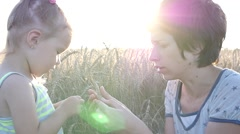 Stock Video Footage of Mother and little daughter in a wheat field contact with nature