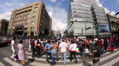 """People walking and crossing street aside the """"Torre Latinoamericana"""" building. Stock Footage"""