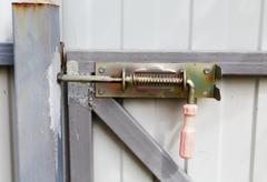 locking bolt on an iron fence - stock photo