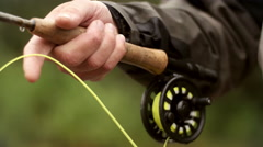 Fly-Fisherman Managing his Line - stock footage