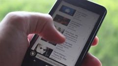 Searching Youtube on a smartphone Stock Footage