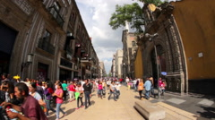 Stock Video Footage of People taking a walk in downtown, in Madero Street.