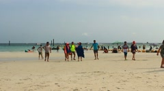 People in beach of coral island, Pattaya, Thailand Stock Footage