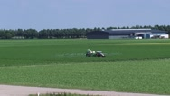 Stock Video Footage of Tractor spraying field in flat polder landscape, North East Polder