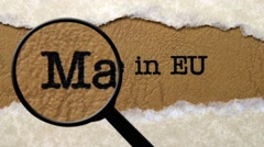 Magnifying glass on made in EU Stock Footage