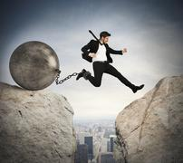 Businessman overcomes obstacles Stock Photos