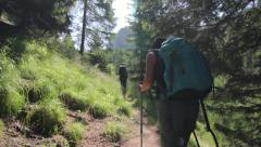 Couple hiking on a mountain path Stock Footage