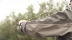 Man Reeling in a Fish from a River - stock footage