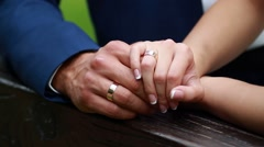 Wedding rings in the hands of the bride and groom - stock footage