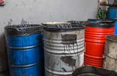 old bins of oil - stock photo