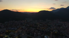 Aerial view of Budva, Montenegro on Adriatic coast after sunset Stock Footage