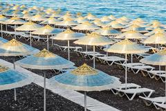 parasol and sun lounger on the beach - stock photo