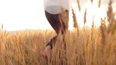 Beautiful Blonde Woman Dancing in a Wheat Field - stock footage