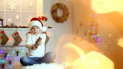 Christmas festivity. Cute happy kid with firework - stock footage
