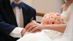 Bride and groom with rings holding hands together Stock Footage