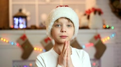 Stock Video Footage of Boy orders gifts for Christmas in home festive interior