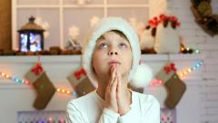 Boy orders gifts for Christmas in home festive interior Stock Footage