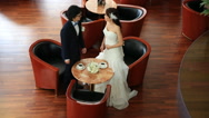 Stock Video Footage of Bride and groom in love sitting and posing in a cafe