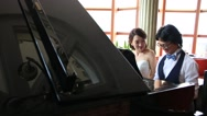 Stock Video Footage of Bride and groom playing the piano together