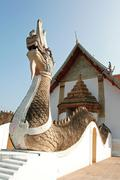 Serpent and Buddhist Temple - stock photo