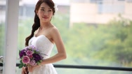 Stock Video Footage of Beautiful bride in love standing in front of window and posing