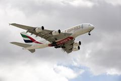 Stock Photo of Emirates Airbus A380 passenger jet with landing gear down preparing to land