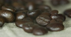Brown coffee beans, close-up of coffee beans for background and textures Stock Footage