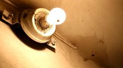 Broken lamp in old abandoned house. Dirty ceiling with web and spiders - stock footage