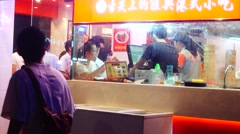 Delicious snack bar in Shenzhen, China Stock Footage