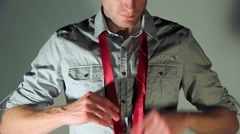 Business man tying a tie - stock footage
