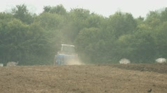 Tractor with plough on a field in germany Stock Footage