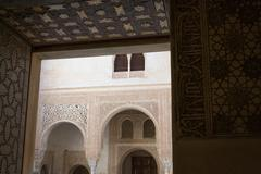 Walking towards a court in Alhambra - stock photo