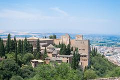 Alhambra and the mountains - stock photo