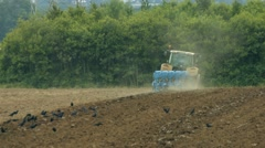 Tractor ploughing acre in germany Stock Footage
