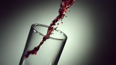 wine, grape juice, pomegranate juice, cherry juice is poured into a glass - stock footage