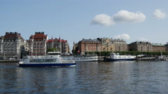 Classic builings in Östermalm with cruise ship passing by in Stockholm Sweden Stock Footage