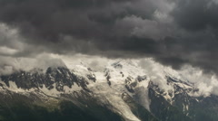 Aguilles du Chamonix Glaciers and dark clouds time lapse Stock Footage