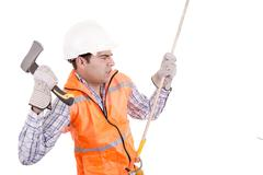 adult man wearing safety equipment descending a rope - stock photo