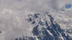 Aguille du Midi and Mont Blanc covered in snow and fog time lapse Stock Footage