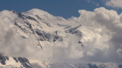 Snow covered Mont Blanc peak  clouds time lapse - stock footage
