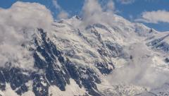 Mont Blanc North face clouds hanging glaciers and Aguille du Midi cable station Stock Footage