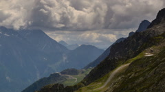 Stock Video Footage of Chamonix valley dark clouds and cabin on ridge time lapse