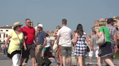 Crowded with people, gondolas and water taxi at pier Canal Grande Stock Footage